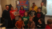 Teacher Jane Larson with students, Steelheaders and the Middle School Principal.